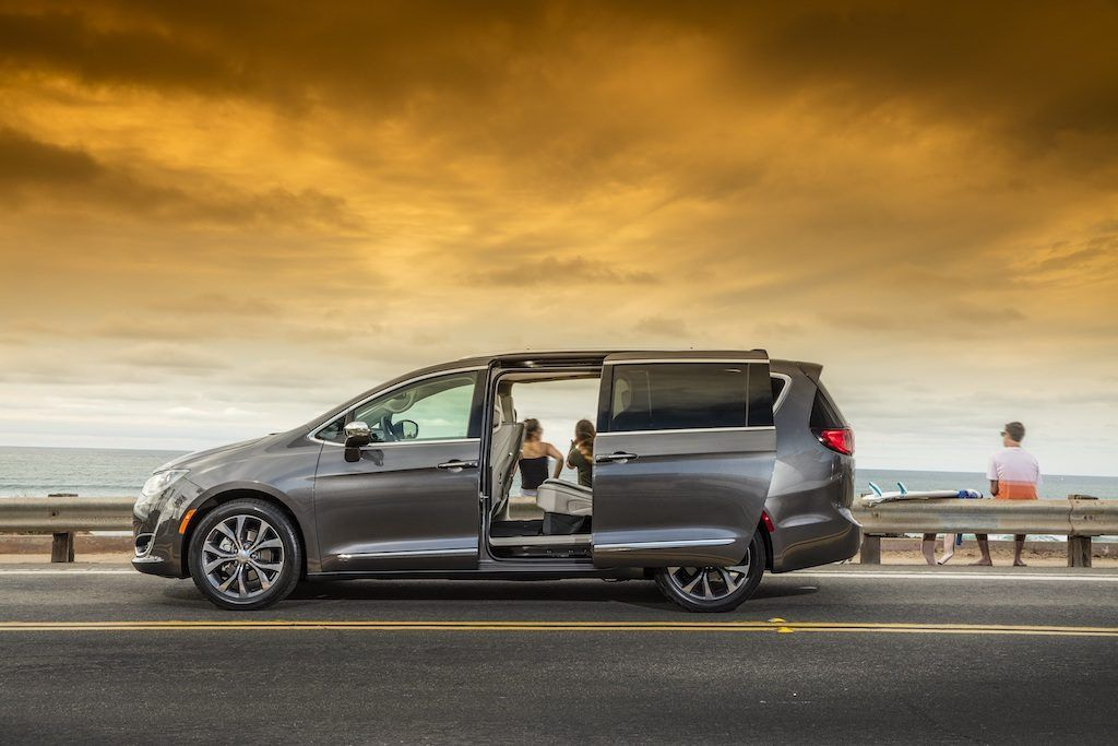 Profile view of gray Chrysler Pacifica with back door open