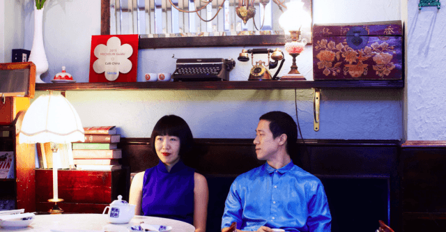 two people sitting in Café China