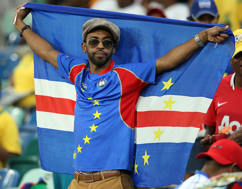 A Cape Verde fan holds a flag aloft during the 2013 African Cup of Nations