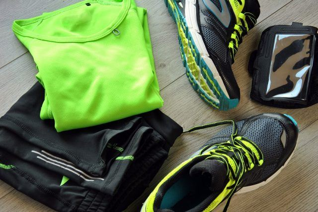 Neon green clothing with sneakers and accessories.