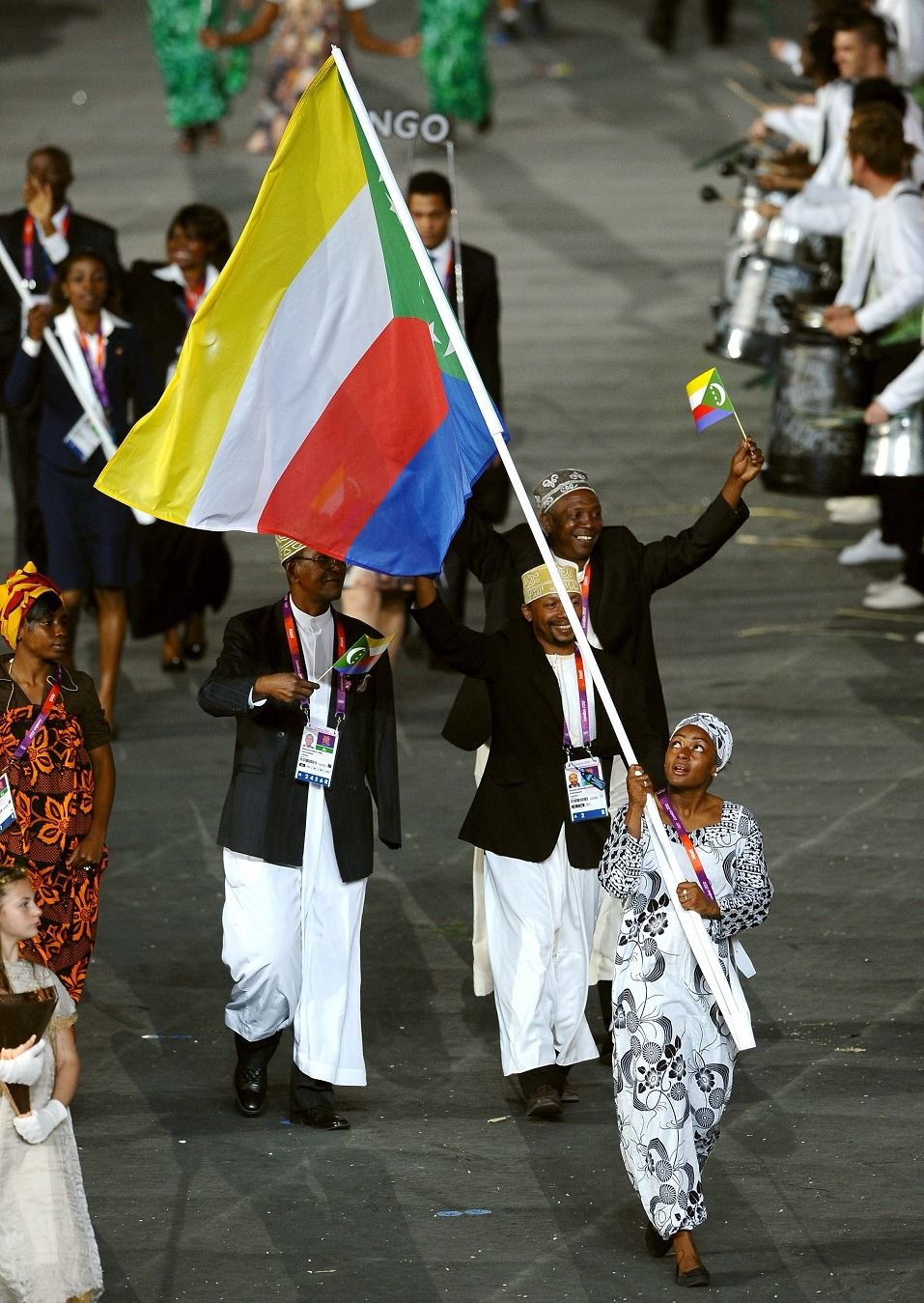 Feta Ahamada of the Comoros Olympic athletics team carries her country's flag