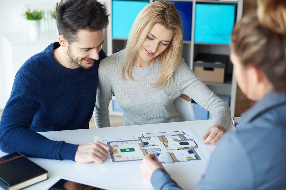 Couple meeting with real estate agent