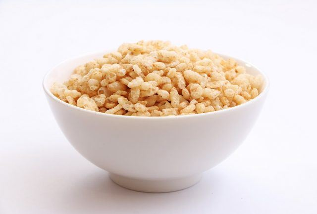 Bowl of crispy rice cereal on top of a white counter.