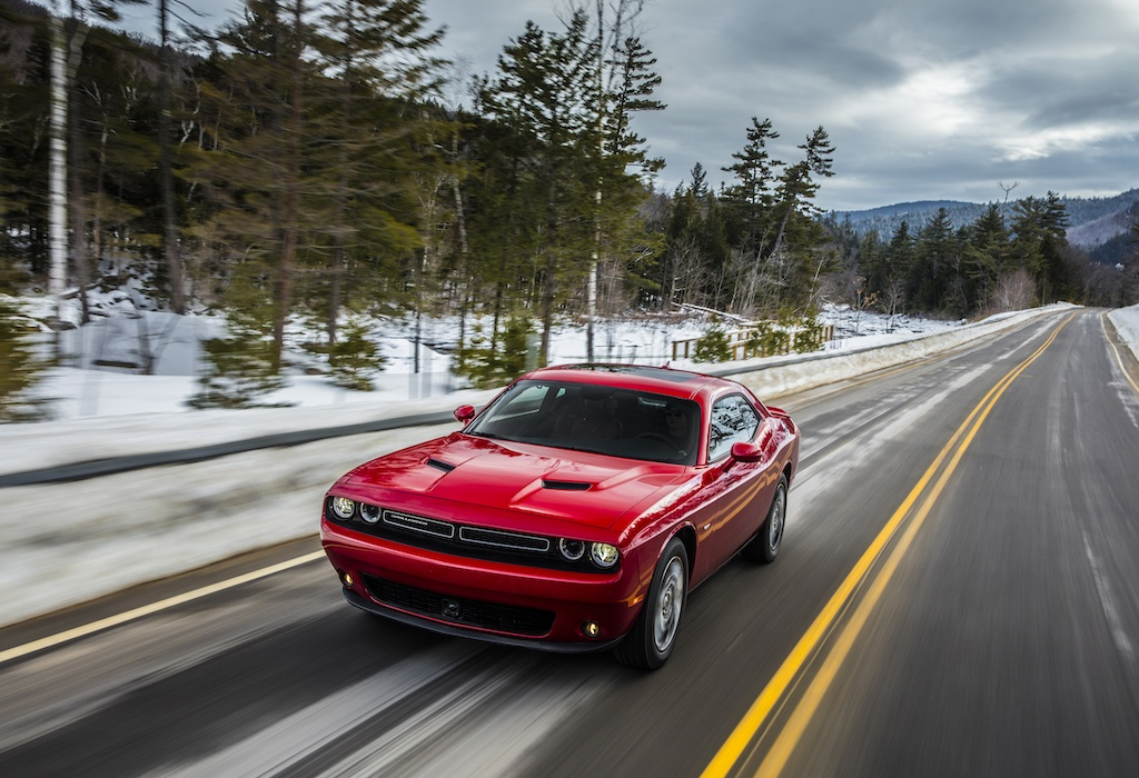 A red 2017 Dodge Challenger GT AWD driving fast on the open road