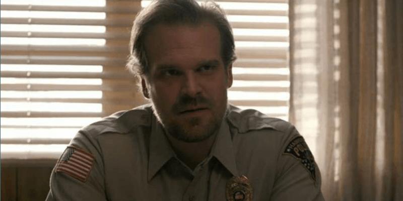 David Harbour dressed as police officer Jim Hopper