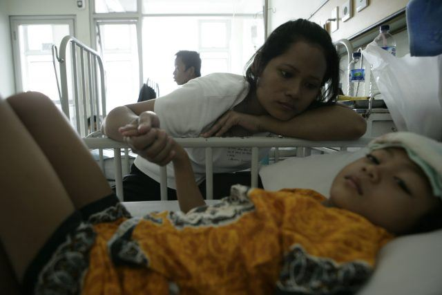 a child being treated for a fever in the hospital
