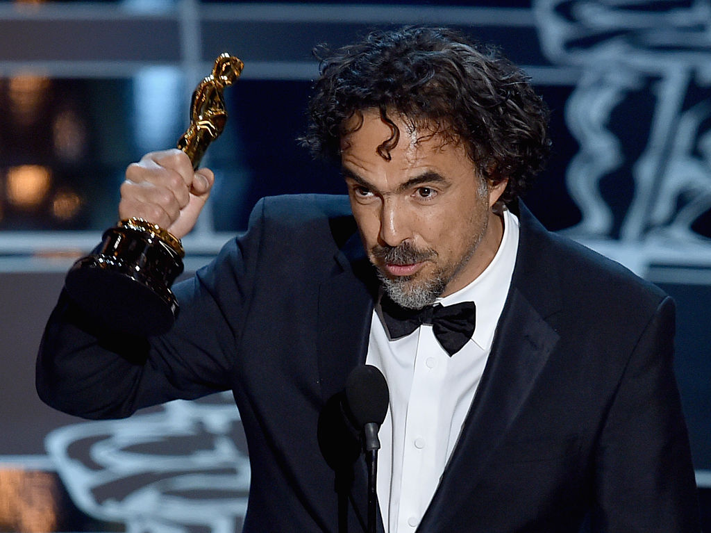 Director Alejandro Gonzalez Inarritu accepts the Best Director Award for 'Birdman'