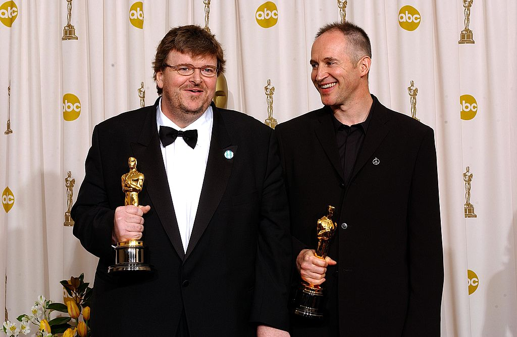 Directors Michael Moore and Michael Donavan pose during the 75th Annual Academy Awards