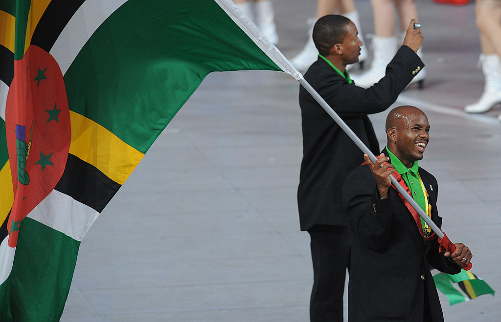 Dominica's flag bearer parades in front of his delegation