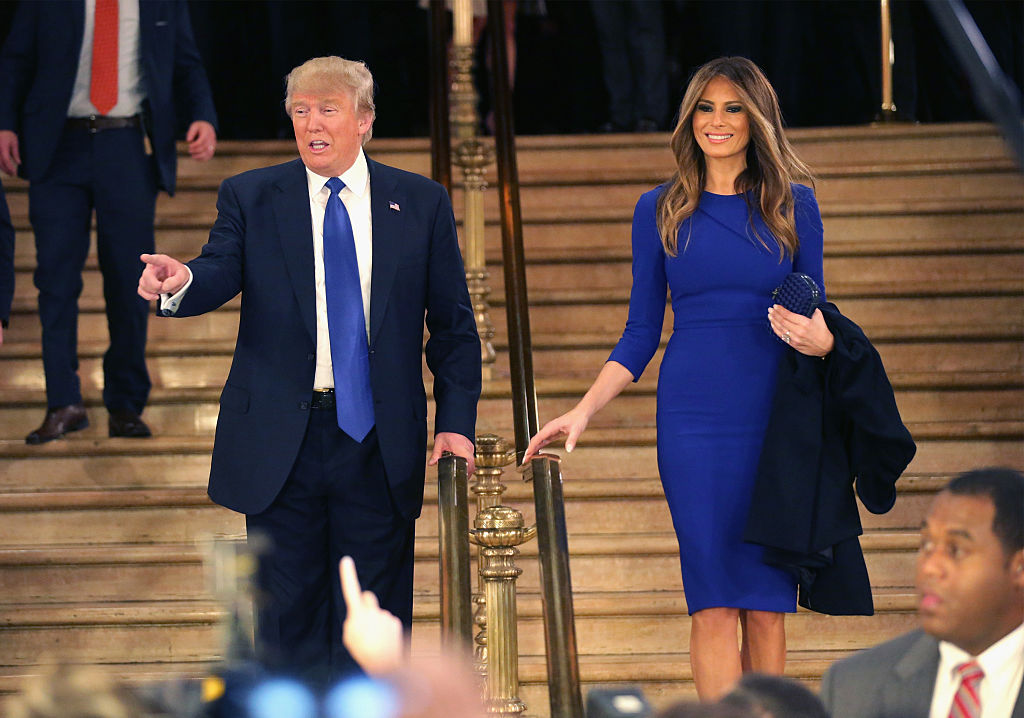Donald Trump and his wife Melania greet reporters