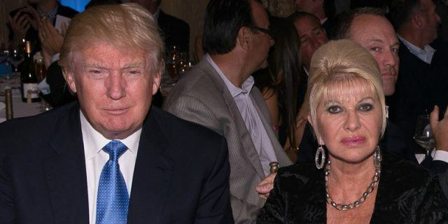 Donald and Ivana Trump sitting together at a dinner.