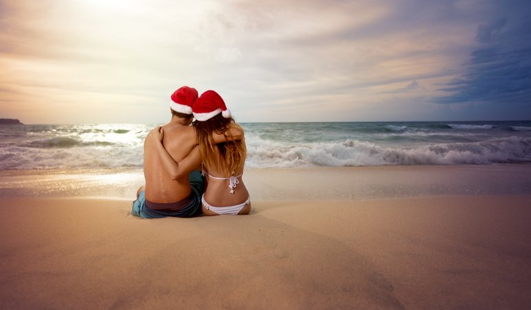 Couple on beach looking at sunset