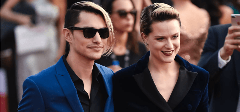Evan Rachel Wood and Zach Villa pose on the red carpet.