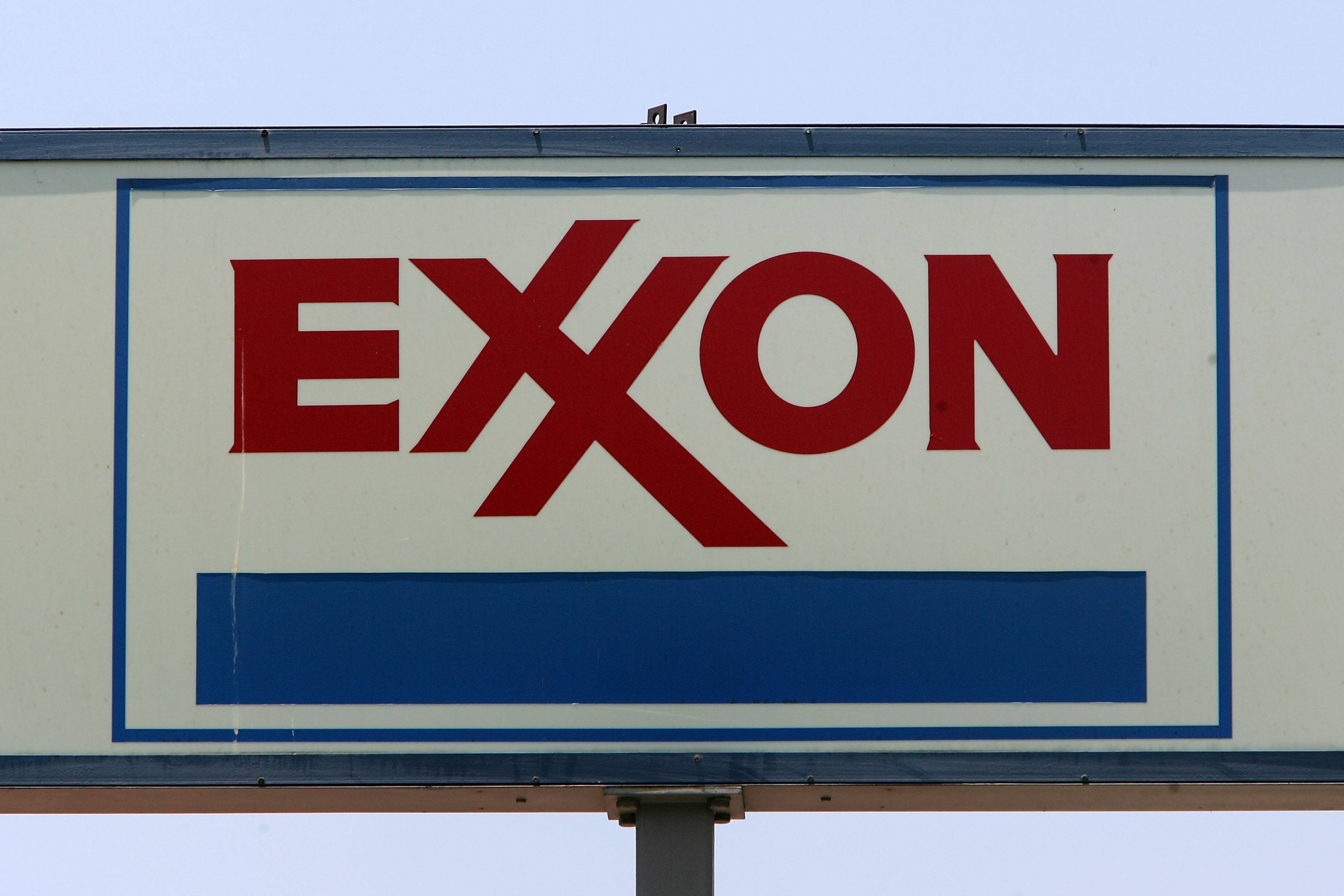 A sign advertises an Exxon gas station