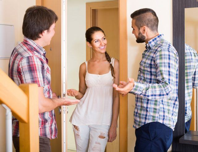 couple inviting friend in the apartment