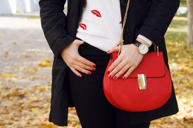 Fashion girl wearing a red leather bag