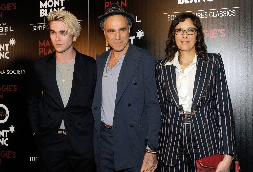 Gabriel Day Lewis, Daniel Day Lewis, and Rebecca Miller pose together on the red carpet.