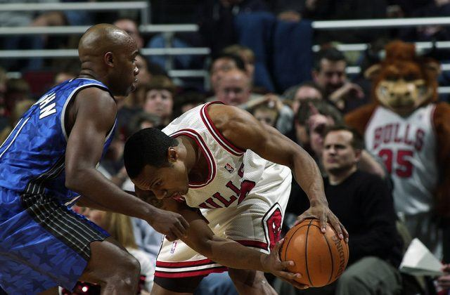 Two basketball players on a court.