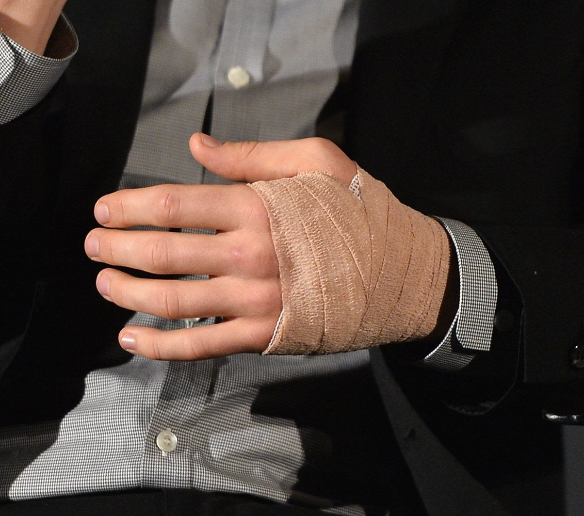 Man with his hand tied up