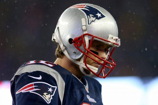 Tom Brady on field while it is snowing