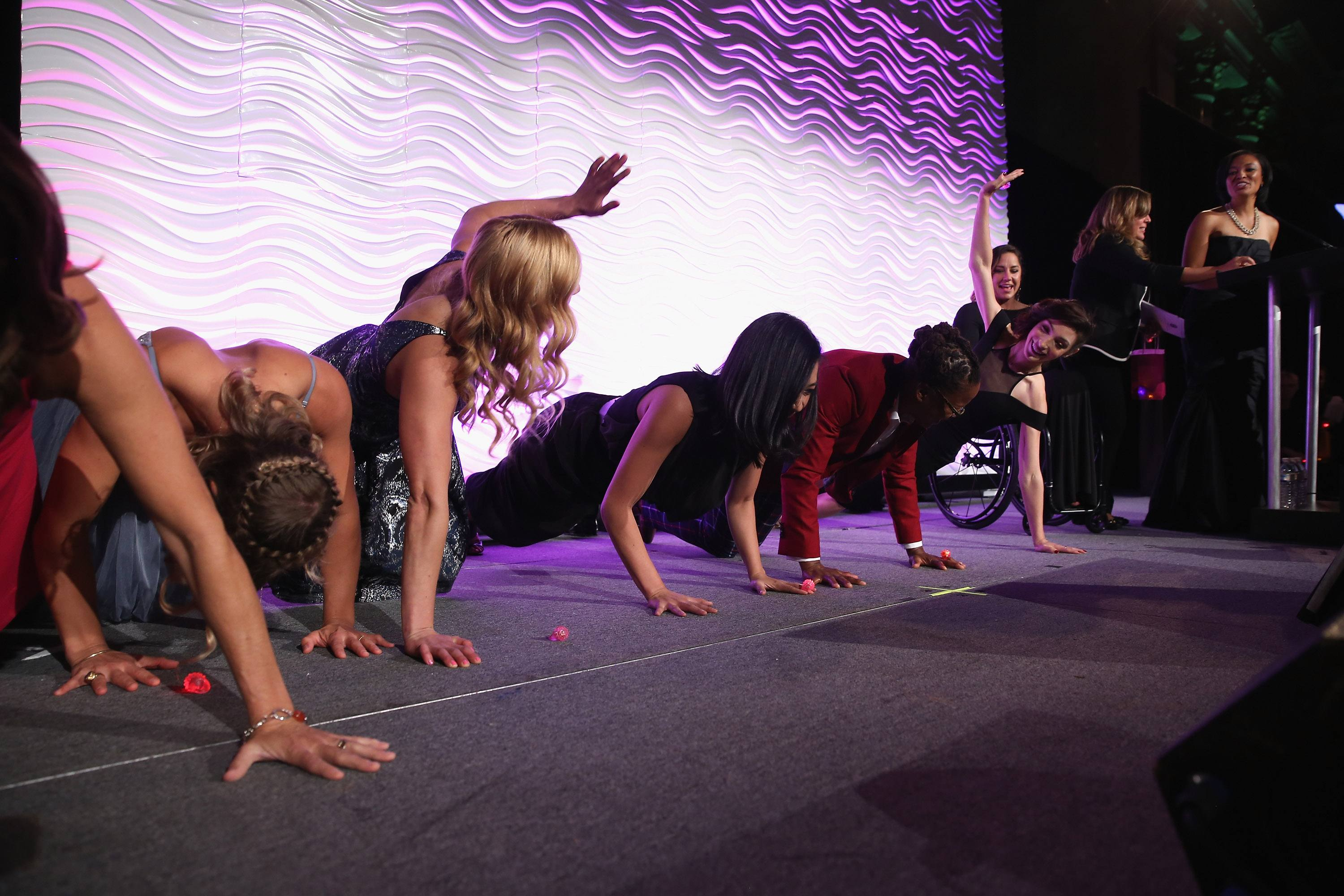 Athletes perform pushups onstage during the 36th Annual Salute to Women In Sports