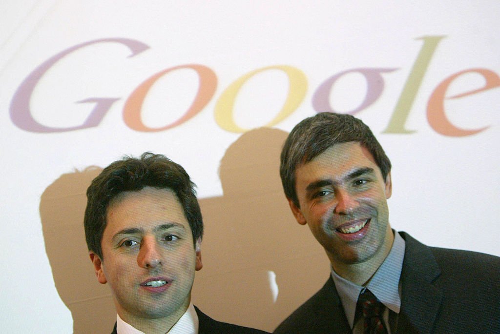 Google founders Sergey Brin, left, and Larry Page pose for photographers