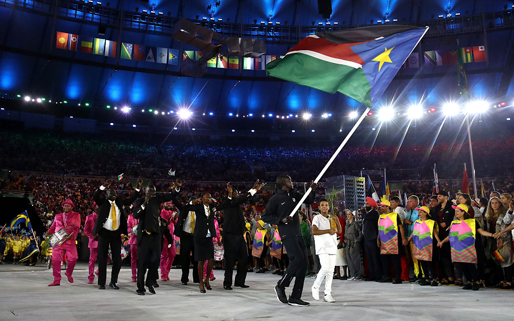 Guor MArial of South Sudan carries the flag