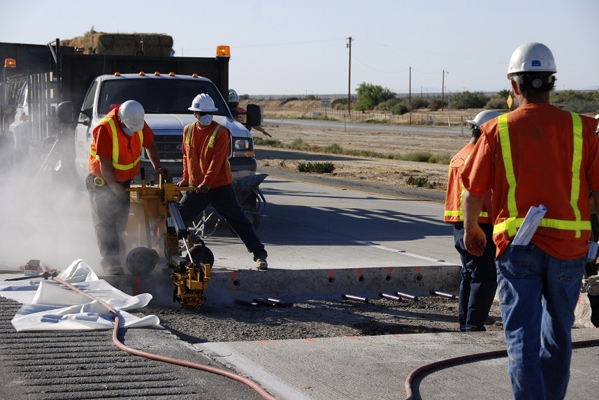 Workers making roadway repairs