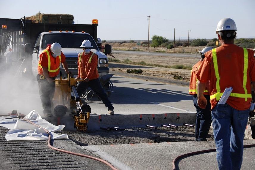 Workers making roadway repairs