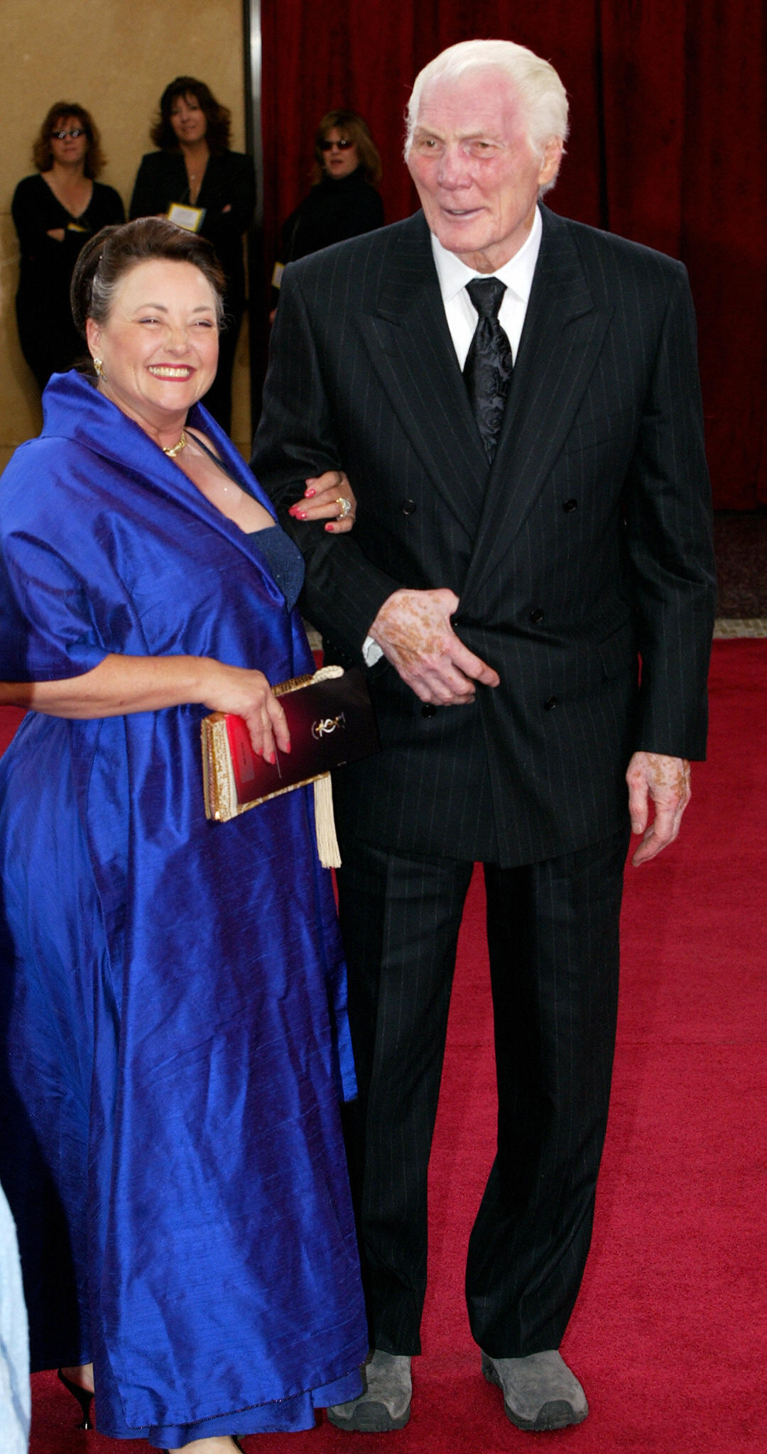 Jack Palance arrives with his wife Elaine
