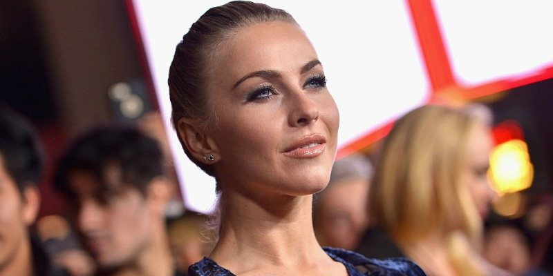 Actress Julianne Hough standing in a crowd posing for the camera