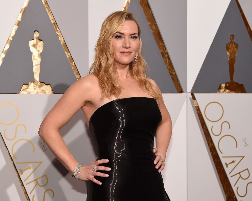 Actress Kate Winslet stands with her hands on her hips at the 88th Annual Oscars