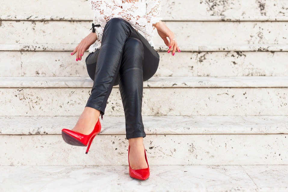 Lady with red high heel shoes