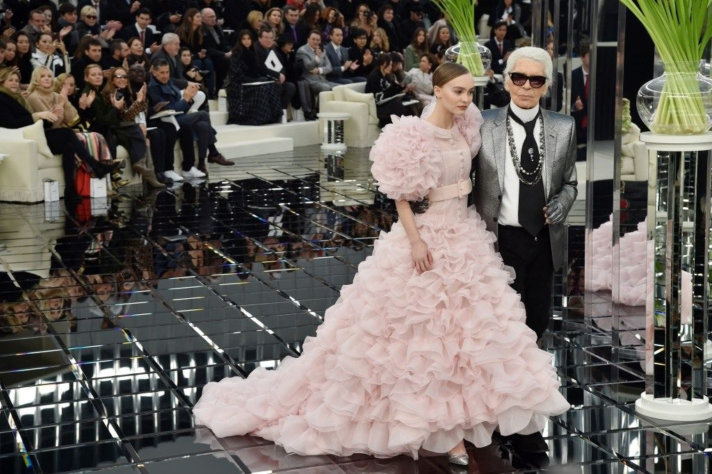 Lily-Rose Depp is in a puffy pink dress standing next to Karl Lagerfeld.