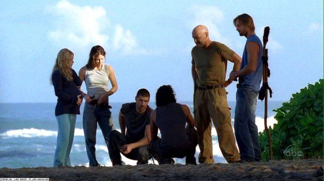 The cast of 'Lost' talking together on a cliff.