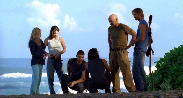 The cast of 'Lost' standing on a cliff together.