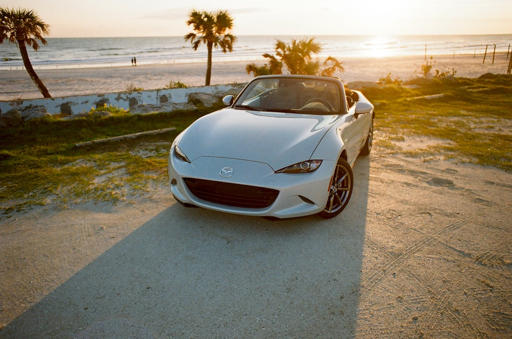 2017 Mazda Miata GT parked on a beach
