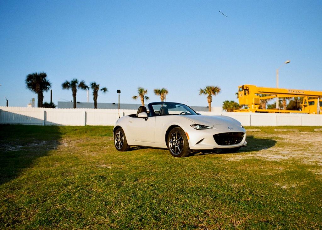2017 Mazda Miata GT parked on a lawn