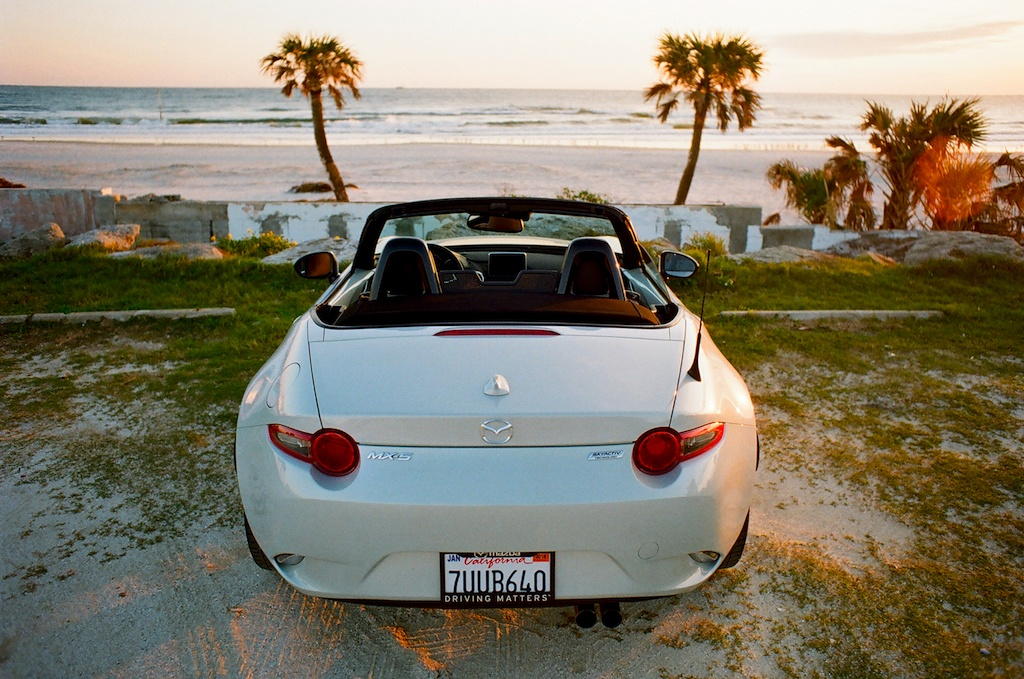 rear view of the 2017 Mazda Miata GT parked on a beach