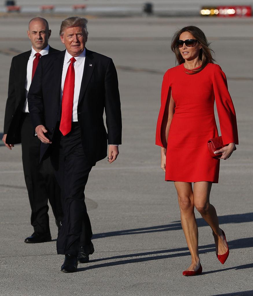 U.S. President Donald Trump walks with his wife Melania Trump