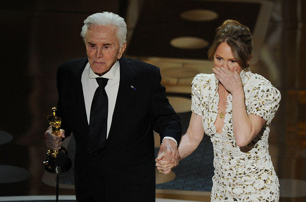 "Presenter Kirk Douglas shakes hands with actress Melissa Leo after Leo won the Actress in a Supporting Role award for ""The Fighter' onstage during the 83rd Annual Academy Awards"