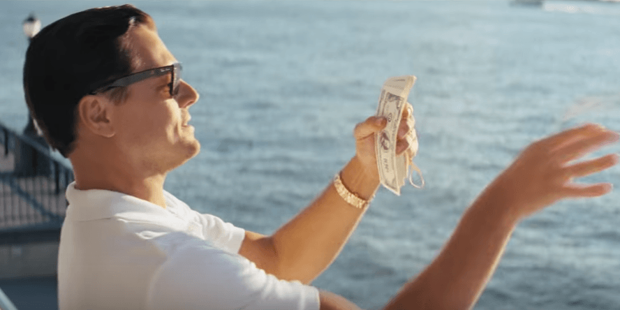 Wolf of Wall Street character with money in hand