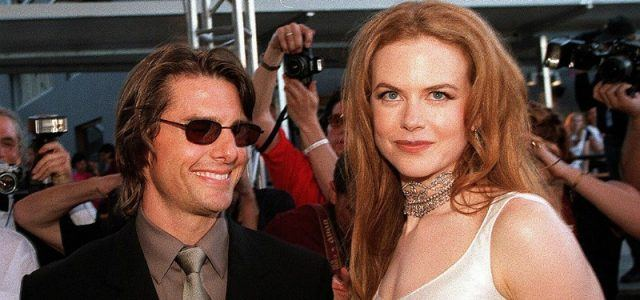Nicole Kidman and Tom Cruise on a red carpet.