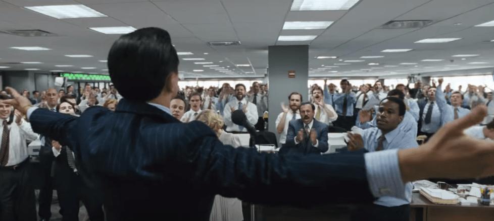 colleagues applauding boss