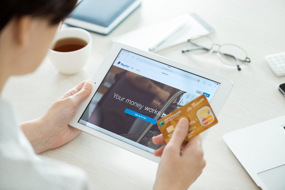 Apple iPad Air with Paypal website on a screen