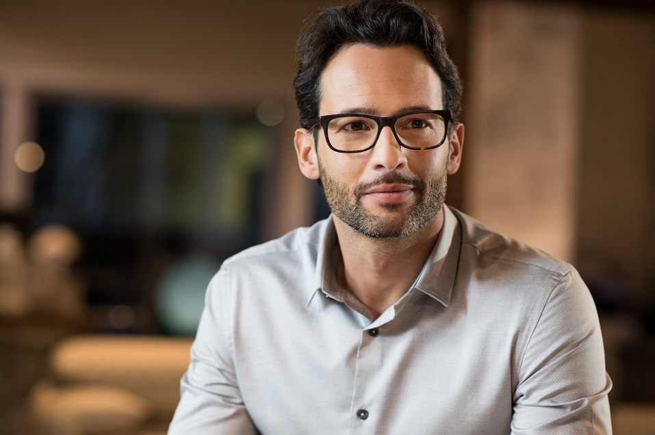 Young handsome businessman wearing glasses