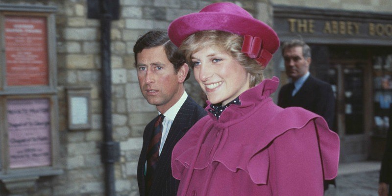 Prince Charles and Princess Diana are walking side by side.