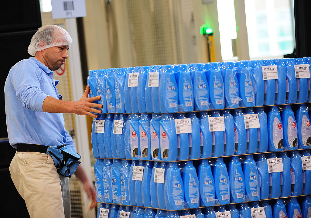 A Romanian worker surveys the packing line at the new Procter & Gamble plant