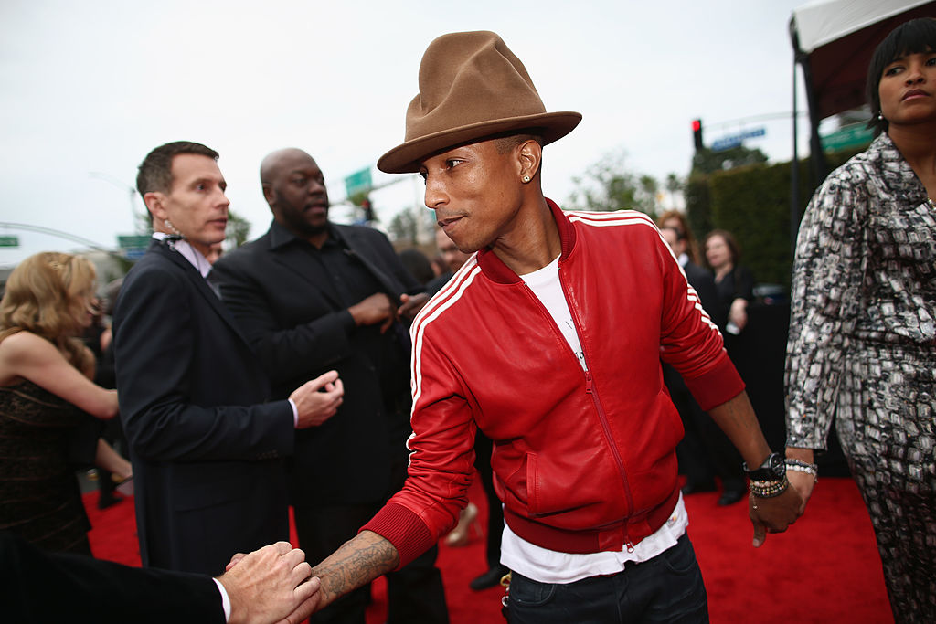 Recording artist Pharrell Williams and Helen Lasichanh attend the 56th GRAMMY Awards
