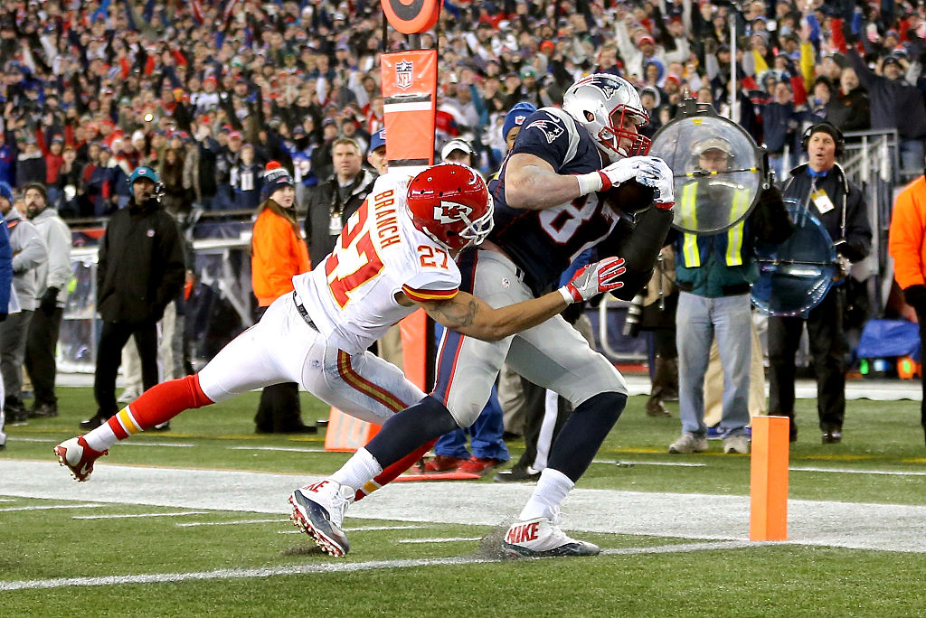 Rob Gronkowski of the New England Patriots catches a touchdown against Tyvon Branch of the Kansas City Chiefs during the AFC Divisional Playoff Game.
